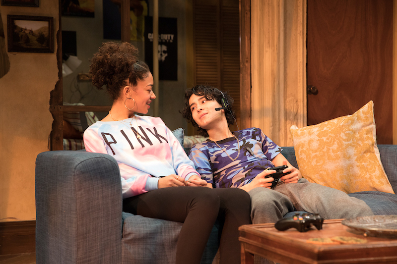 Cindy De La Cruz as Marie, with video game-playing Mateo Ferro as her younger brother Butchie