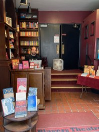 Bravo's Book Nook. The doors behind manager Jory Southurst are the entrance to the Players Theater auditorium