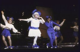 """Actresses Carol Channing (2L) & Leslie Uggams (3R) w. cast in a scene fr. the National tour of the musical revue """"Jerry's Girls""""."""