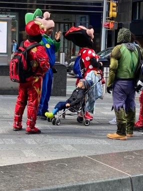 The costumed characters are still standing around, but there are few tourists around to photograph them