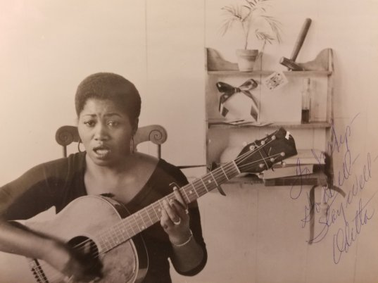 "Do Well. Stay Well."" signs Odetta on this photo from @NYPL_Music 's rare iconography collection. Odetta Holmes (1930-2008) was a singer, guitarist, lyricist, political activist, and a significant figure in the American folk music revival of the 1950s and 1960s. Her blend of folk, blues, ballads, and spirituals has influenced generations of musicians including Joan Baez, Janis Joplin, and Bob Dylan."