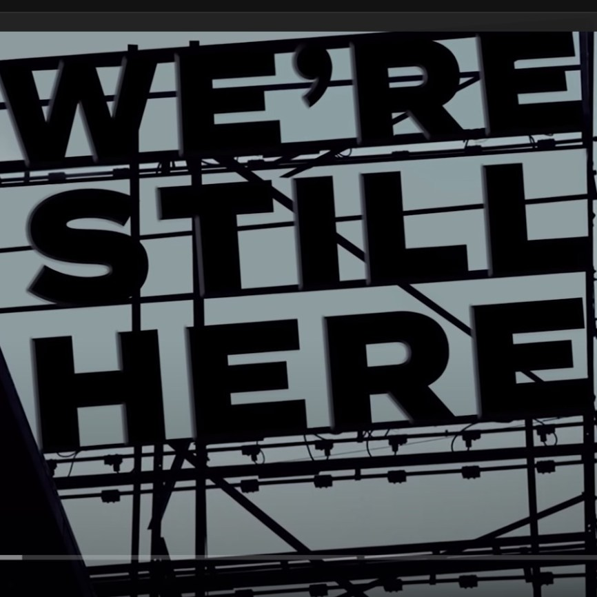 """""""We're Still Here,"""" the opening image of a new video (see below) in which Broadway stars rewrite the lyrics of Sondheim's """"I'm Still Here."""" It's meant to be defiantly optimistic, but there's an unintended and ironic second meaning: We're still stuck here at home."""