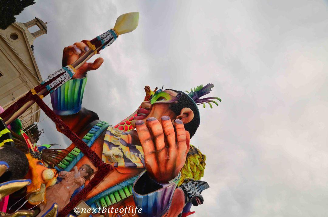 malta carnival float man with staff