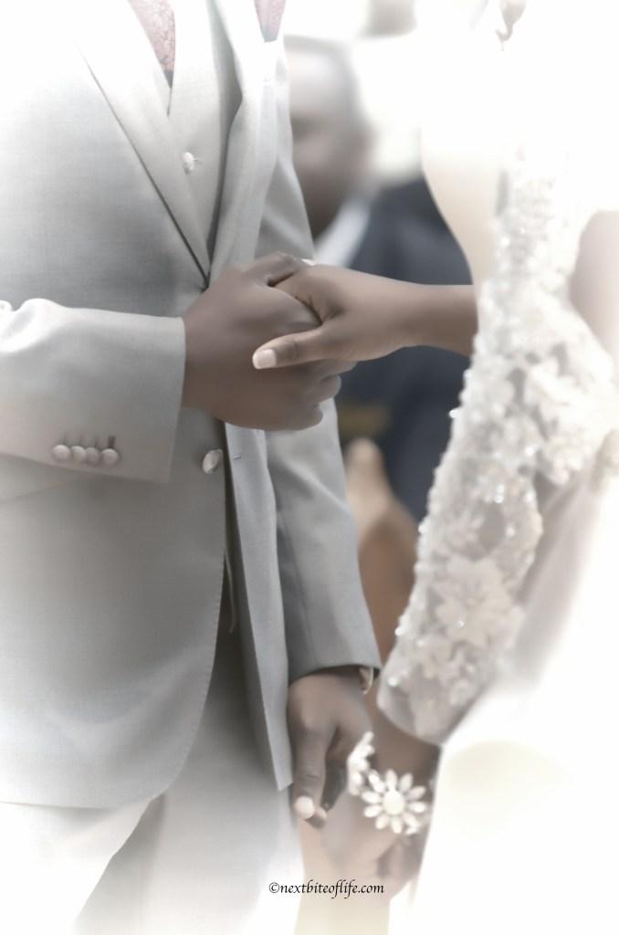 black wedding couple holding hands