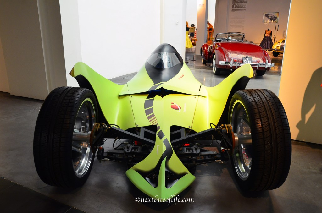 green futuristic car at museum of automobiles Malaga
