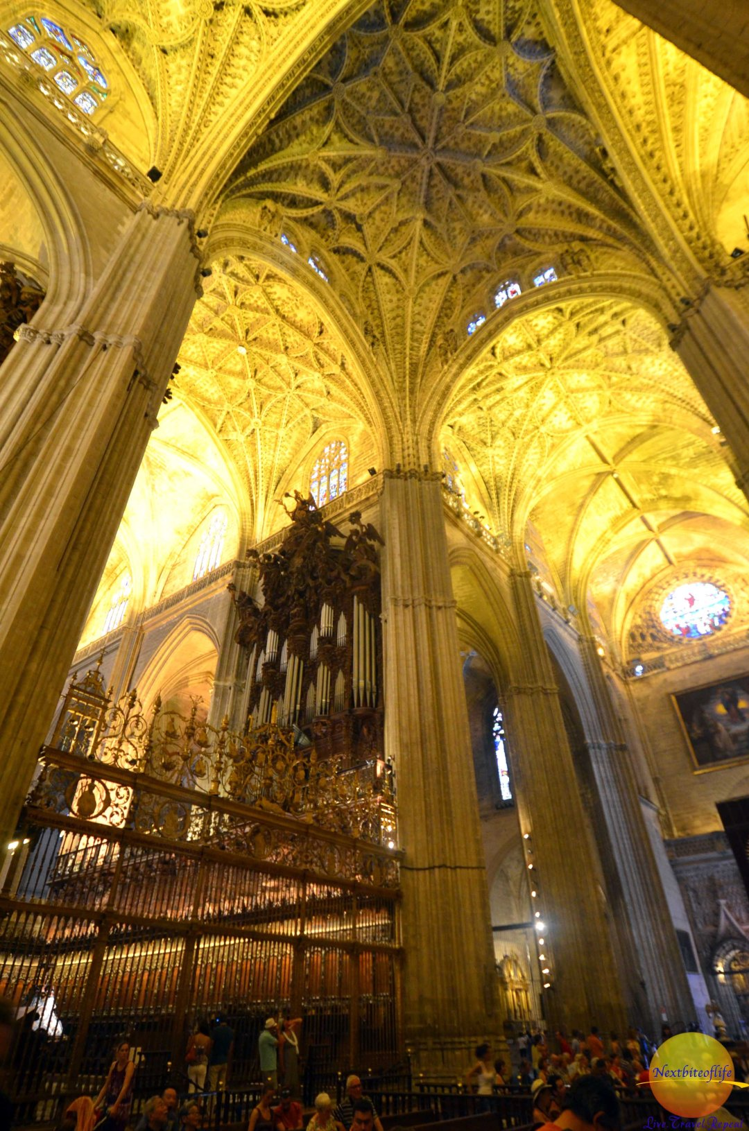 Inside the Seville Cathedral. The altarpiece is behind those gates.