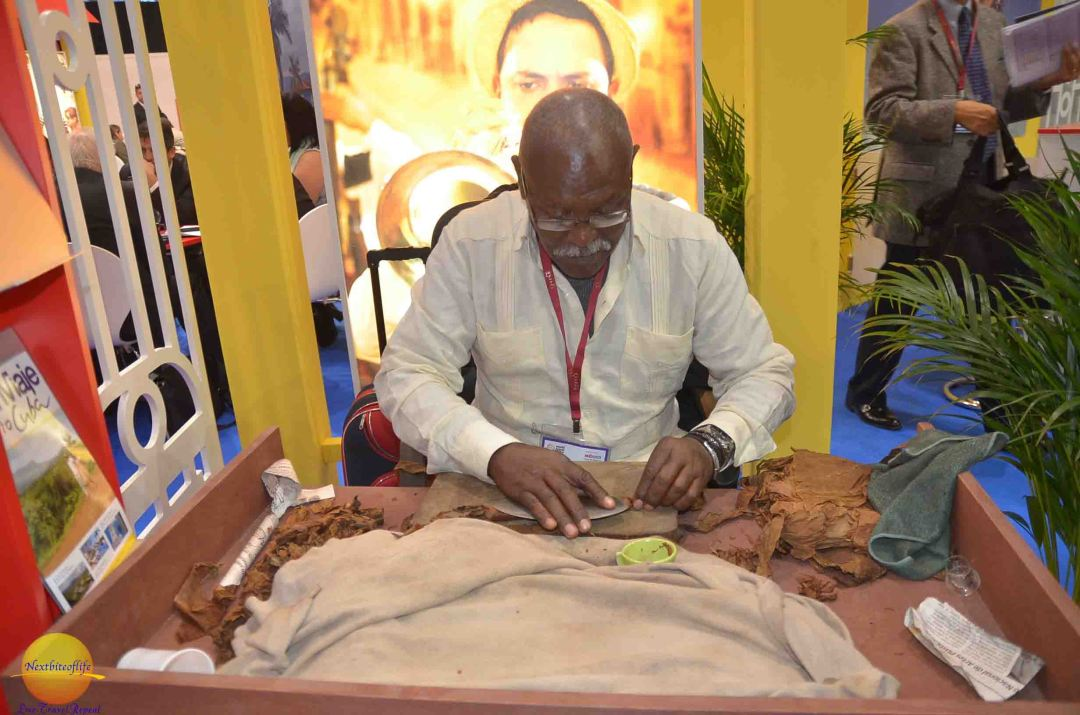 A Cuban man hand rolling the cigars at WTM 2015.