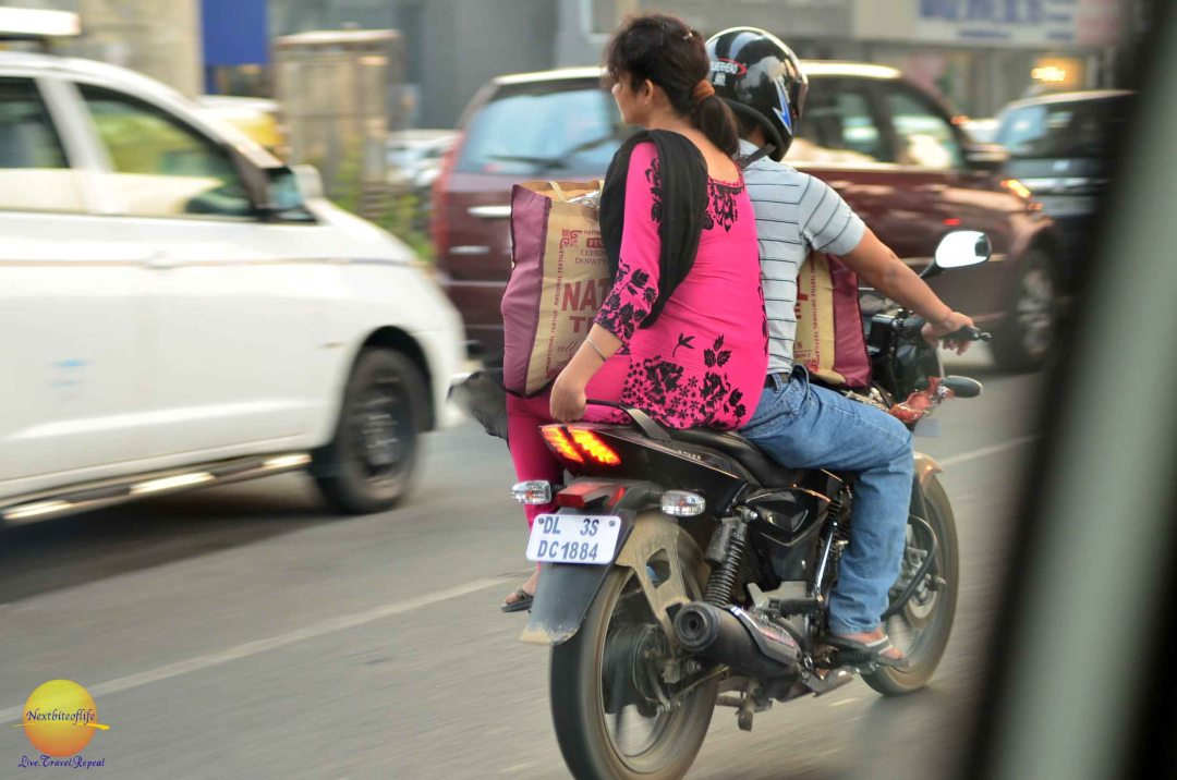 couple on bike in new delhi