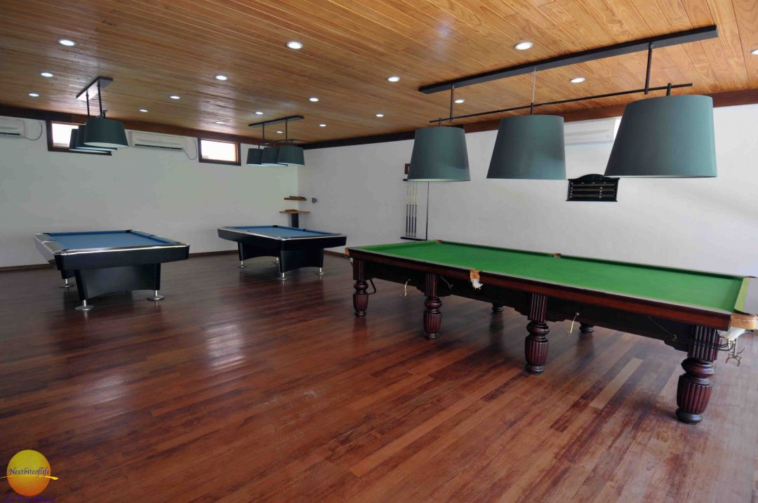 billiards table at the vilamendhoo resort, maldives