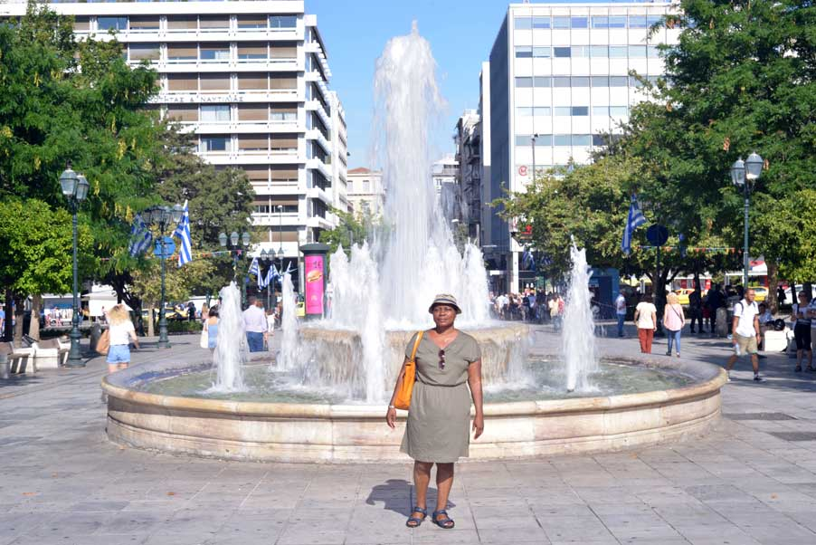 syntagma square with woman at fountain