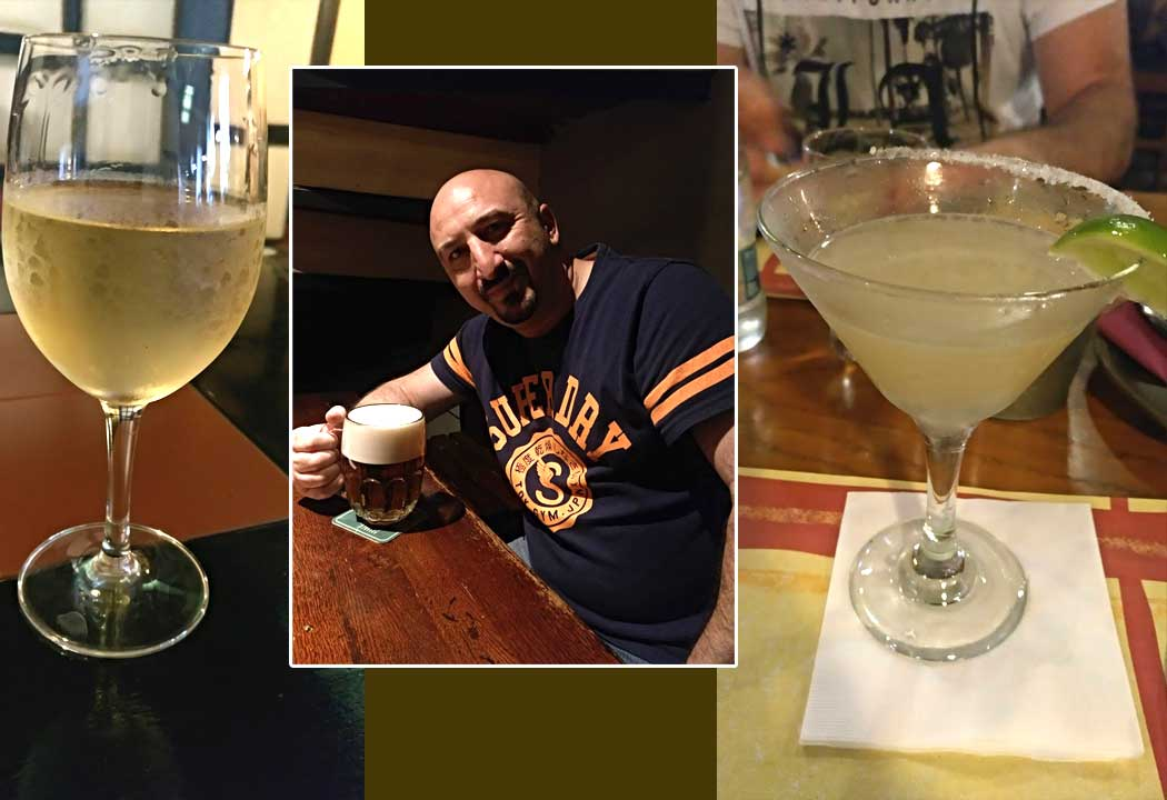 wine and margarita with man in middle in Prague