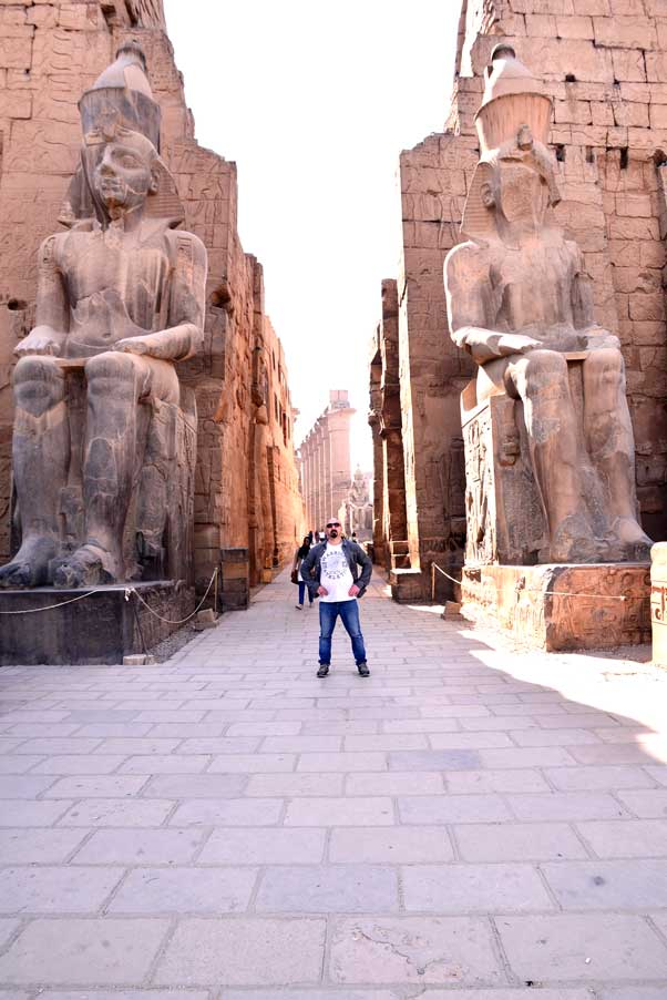 man at entrance to Luxor temple Egypt