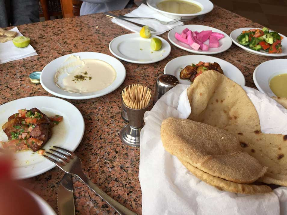 hummus and pita bread and meat