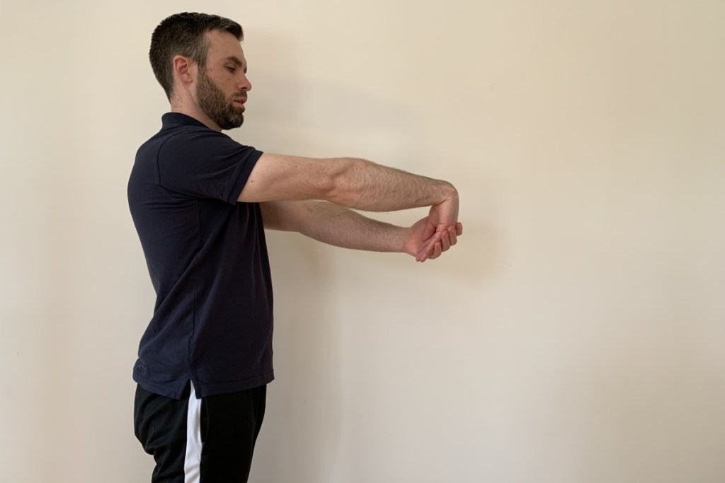 Wrist stretch for tennis elbow treatment