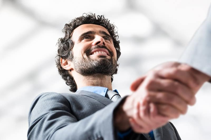 Success in selling is smiling and dialing- Successful businessman