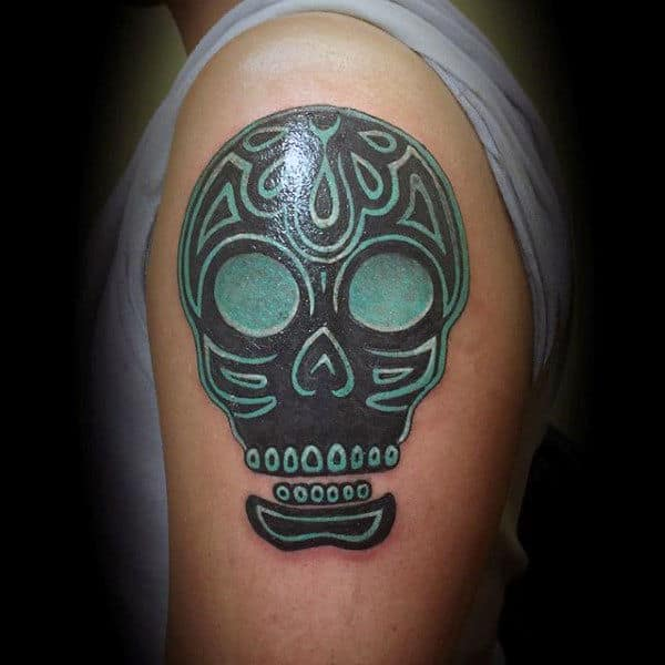 Amazing Sugar Skull Tattoos Guys Tribal Style On Upper Arm With Green And Black Ink
