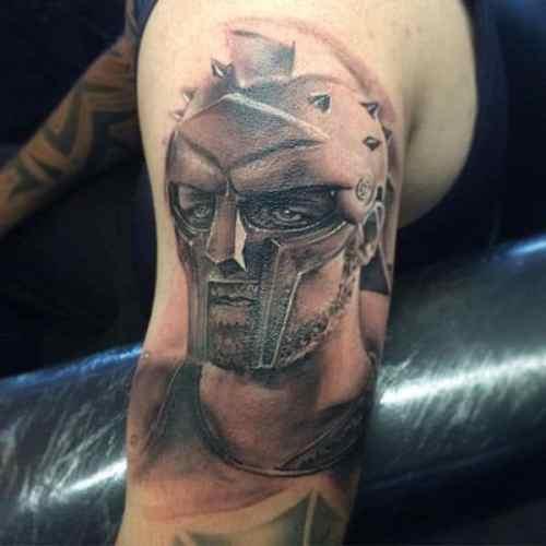a0297398f Originally Published: http://nextluxury.com/mens-style-and-fashion/gladiator -tattoo-ideas-for-men/