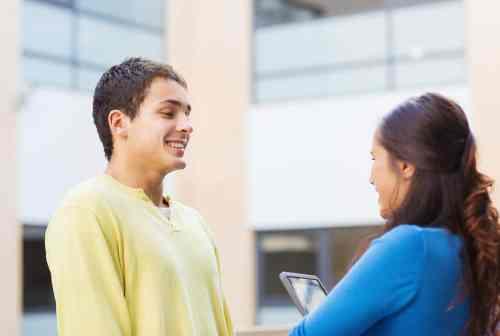 student talking to classmate