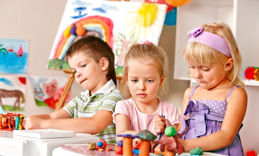 Children sculpting plasticine.