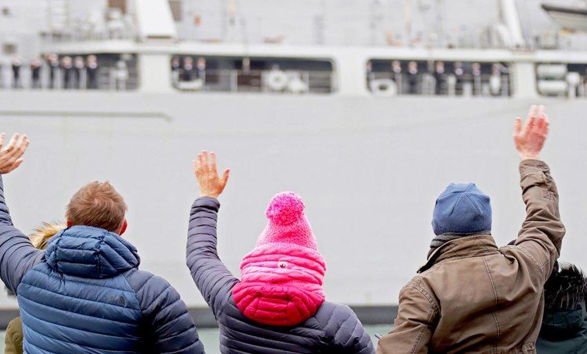 People waving at a leaving ship.