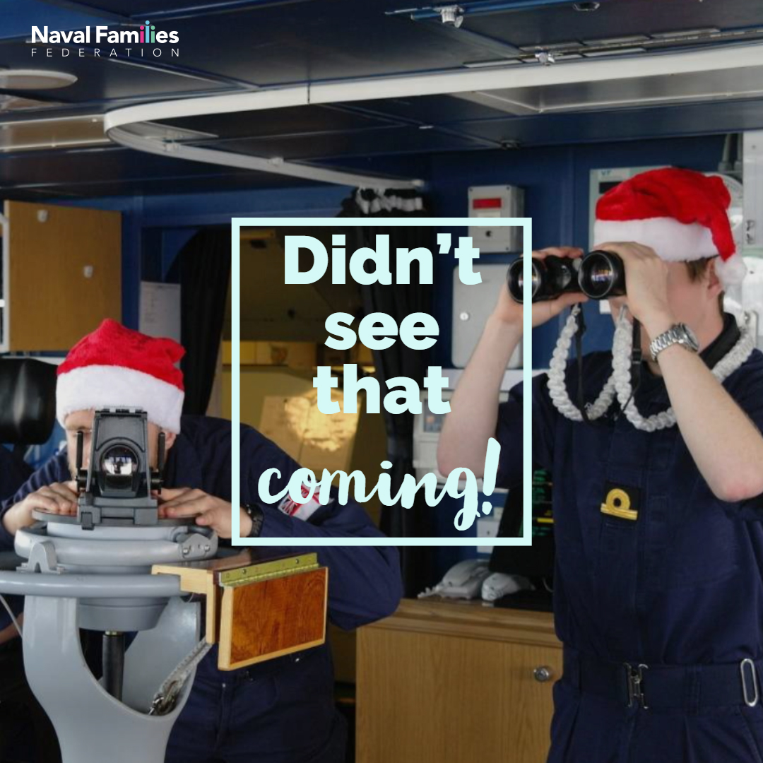 Bridge of a ship with sailors in santa hats.