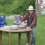 John cutting his cake