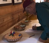 Larry making a bid on Ray Hart's pie