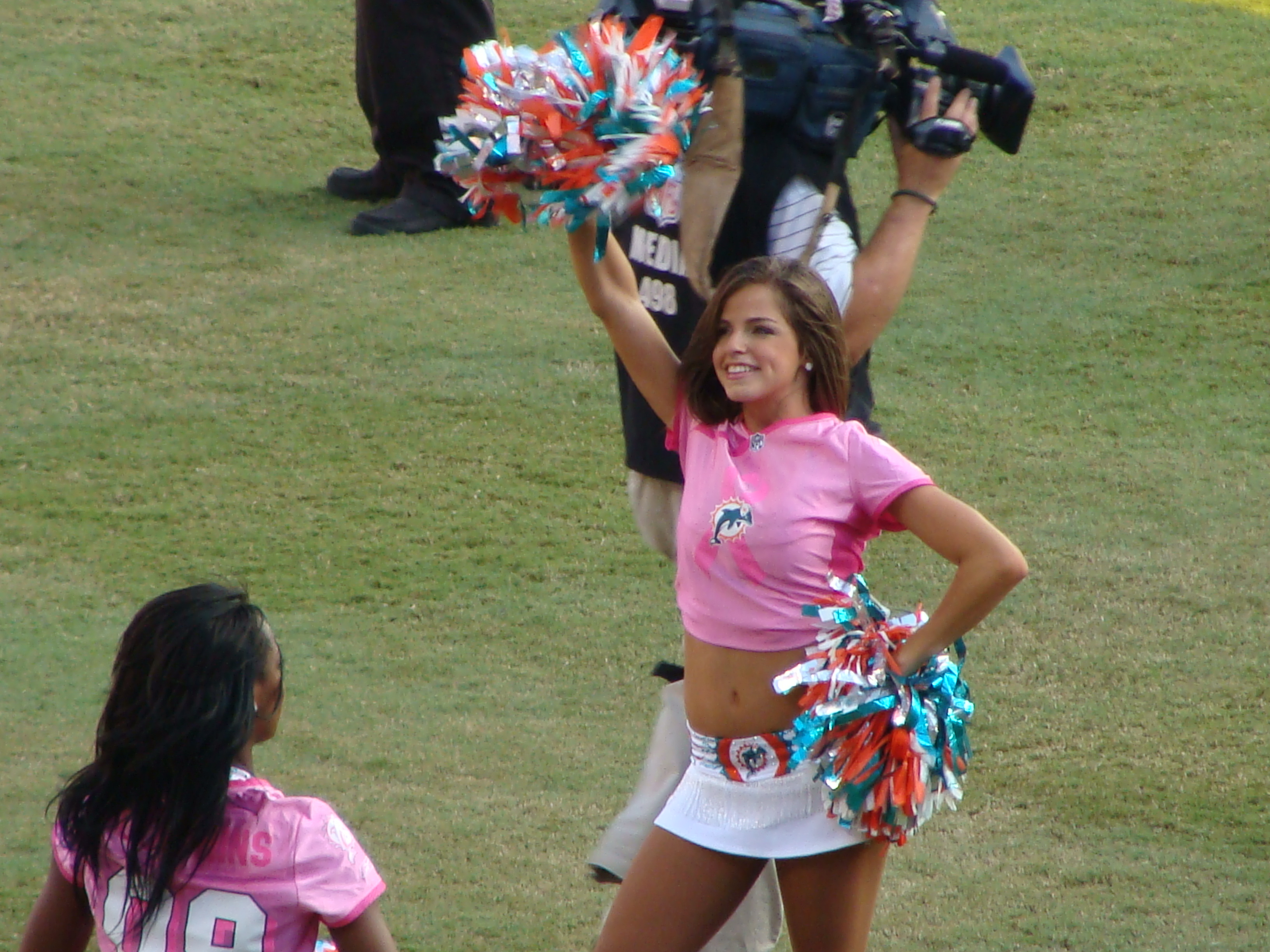 Not that I was lookingat them but the cheerleaders wore pink too
