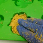 Golden Clover Bath Bombs Recipe Putting the Bath Fizzies in the Mold