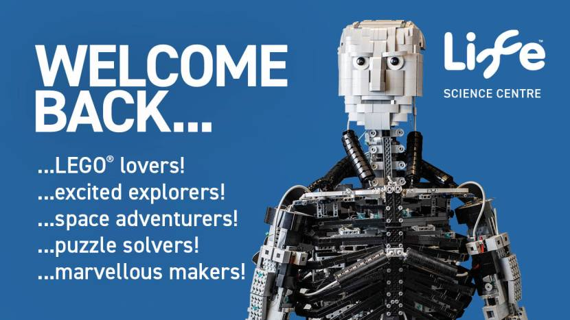 Graphic of a black and white lego robot on blue background with the caption 'Welcome back lego lovers, excited explorers, space adventurers, puzzle solvers, marvellous makers!' in white text.