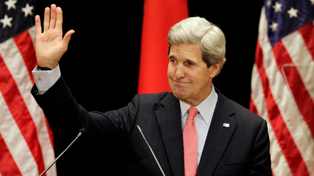 John Kerry waves after delivering speech in Tokyo