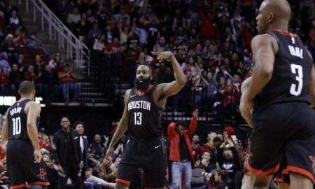 Harden celebrates after hitting a three pointer for the Rockets.