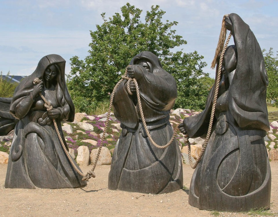Three large statues of the Norns