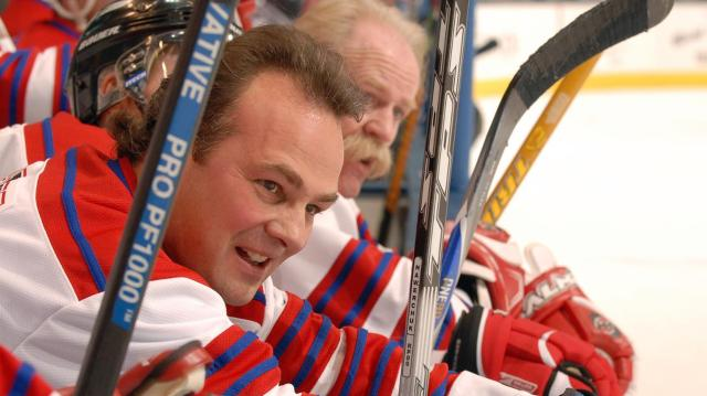 Dale Hawerchuk of Team Canada looks on from the bench during 2006 Hockey Hall of Fame Legends Classic.