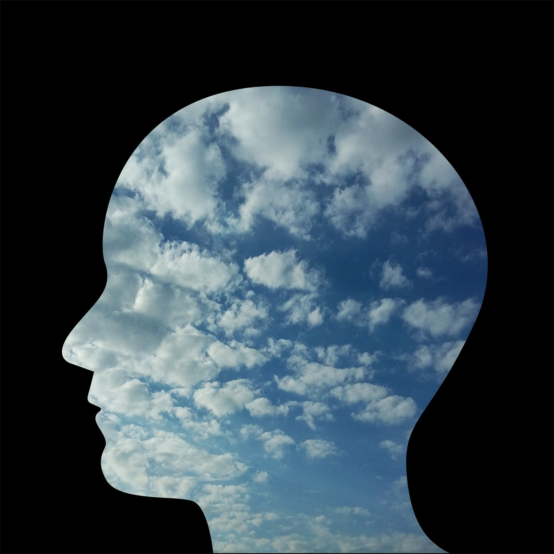 head silhouette with sky and clouds