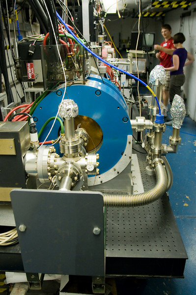 Rather than using radio frequency cavities to accelerate particles, wakefield acceleration uses the wake in a plasma caused by the injection of laser pulses or bunches of electrons: particles get caught up in the wake, much like surfers on ocean waves, and accelerate until their speed matches that of the wake.