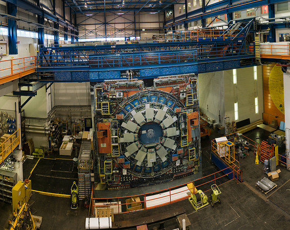 The CDF detector building at the Tevatron. The detector you see in the center is actually just an enormous photograph. The detector itself is nestled behind the door on the right of the above image and is only brought out into the room for repairs.
