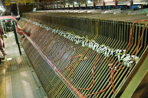 Because neutrinos are so impossibly difficult to detect, physicists layer hundreds of detector plates in the path of the beamline to increase the chances of an event.