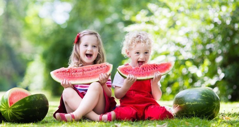 Kids eating watermelon