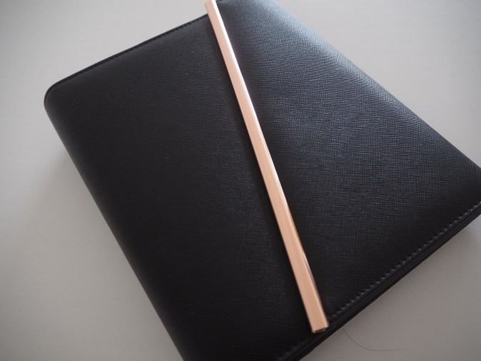 The Happiness Planner black and rose gold binder