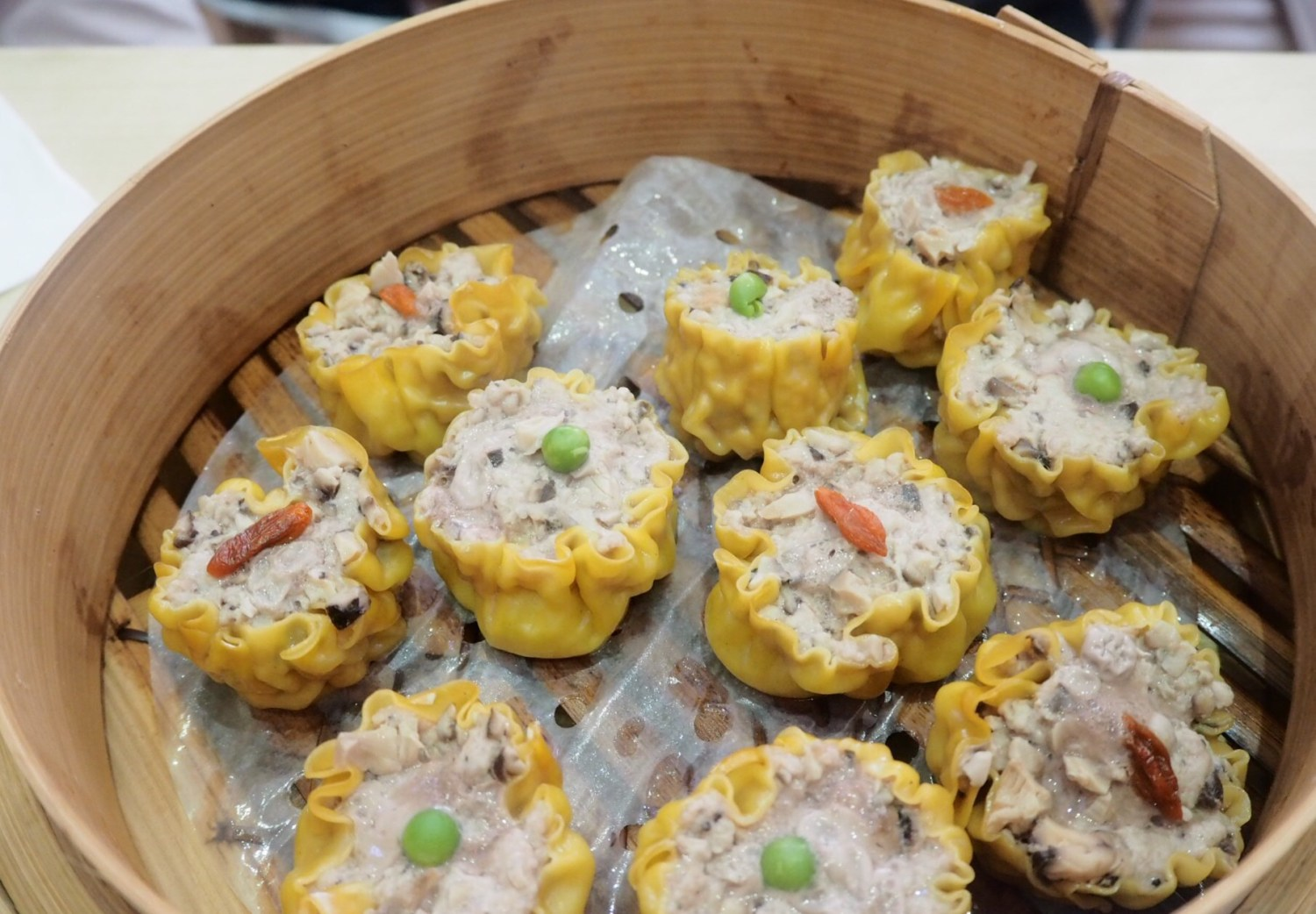 Cooked Sui Mai in a steamed basked