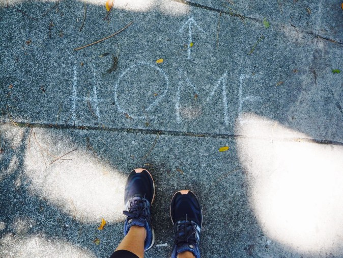 Picture of feet showing the word home with an arrow pointing to tit