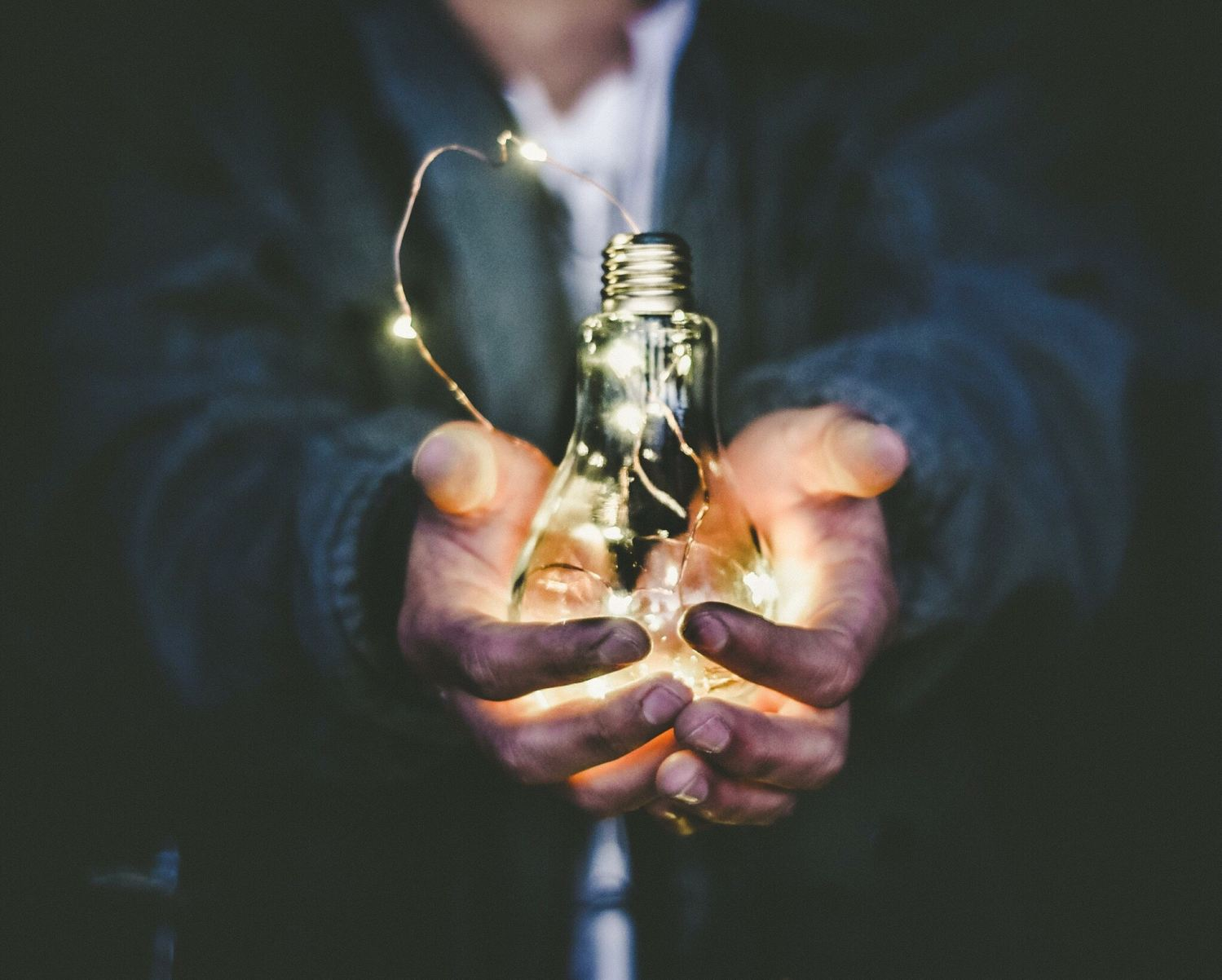 Picture of a man holding a light bulb