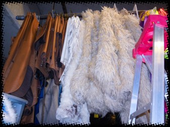 """""""Leather"""" and """"sheep skin"""" chaps. Apparently chaps are used to protect the legs from thorny bushes, animals' horns, etc. They also help you stay on the horse. (Although NOTHING helps me stay on a horse!)"""
