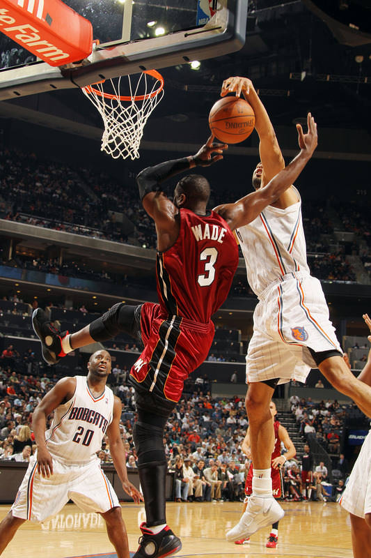 ... Player Edition Black Varsity Red White 387358-007  Dwyane Wade in a new Air  Jordan 2010 colorway and Tyson Chandler wearing the Nike Zoom ... 16e84c017