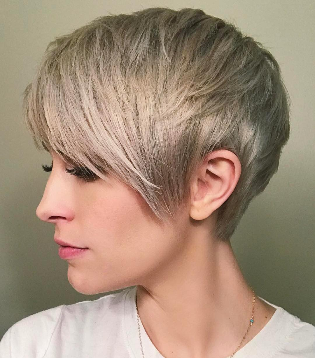 Textured mid-ash-blonde short straight hairstyle