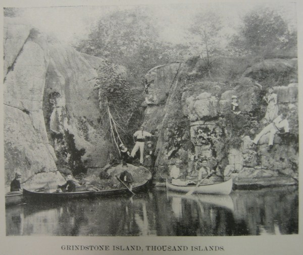 Photograph 1 – Visits to local sites of interest, fishing trips, and picnics were all common activities during the first week of the encampment, which was devoted to socializing and recreating. This photograph depicts a group of canoeists consuming landscapes local to the 1897 meet at Grindstone Island on the St. Lawrence River. Adirondack Museum, American Canoe Association Yearbook, 1897.