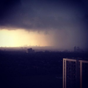 The storm with downtown Toronto in the distance. Photo posted by Amy Rensby.