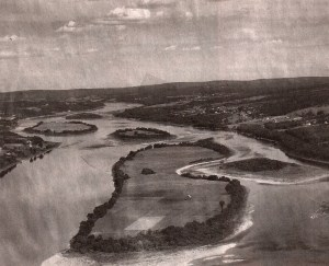 The Saint John River had a number of large islands which were used by local farmers for agricultural purposes. These islands also provided important fish habitat. Shown here are a cluster of islands including Bear Island (centre), whose name now indicates the neighbouring area, as these islands were all inundated when the headpond was created. Photo credit: Nackawic Area Historical Society