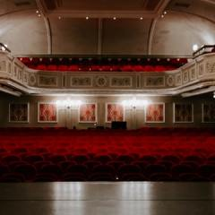 Empty concert hall red seating